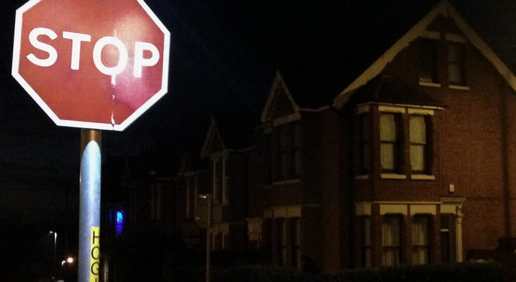 Street stop sign at night in Ramsgate, Kent.