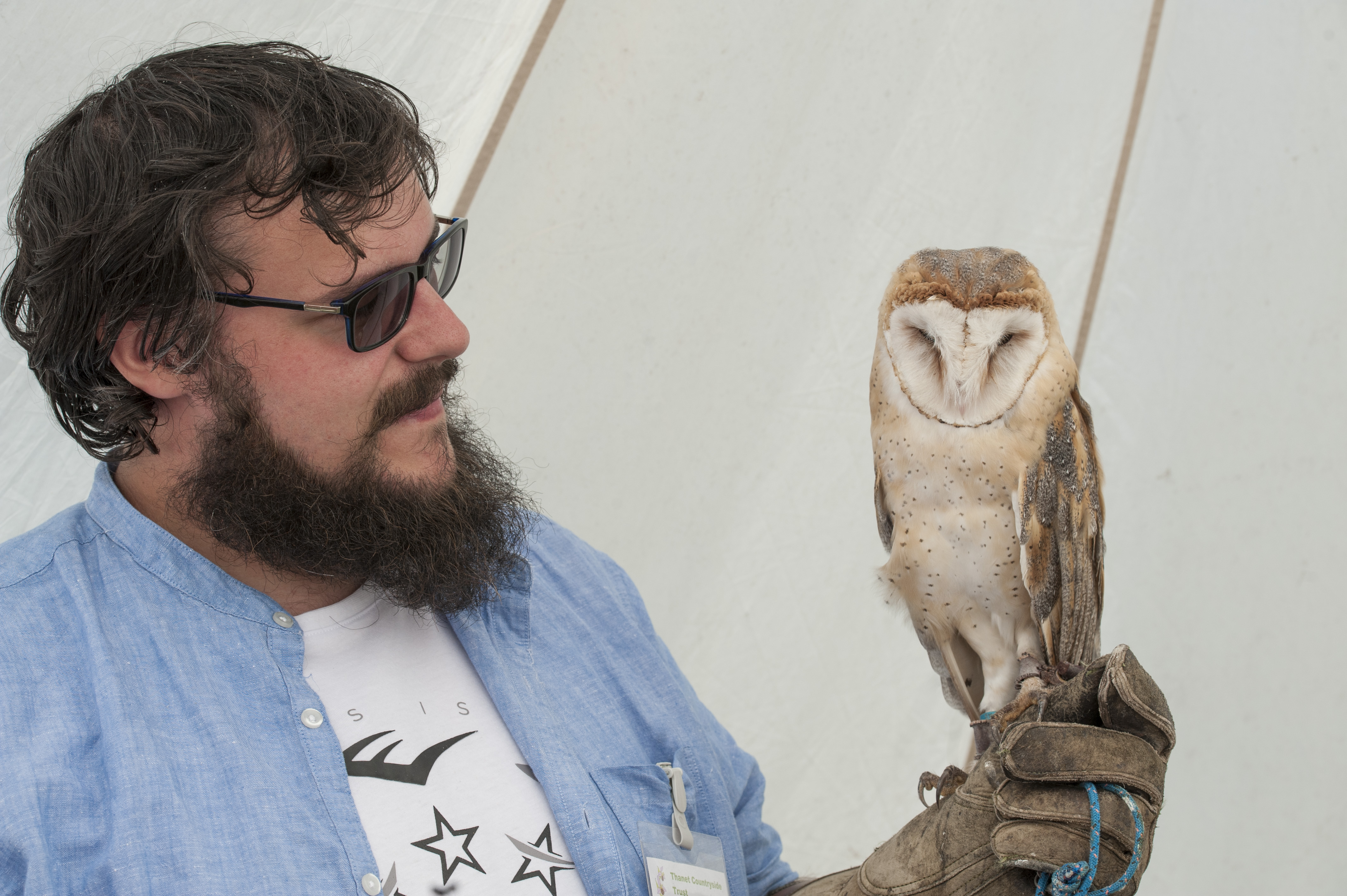 Handling an owl in Monkton Nature Reserve. Image by Chris Constantine.