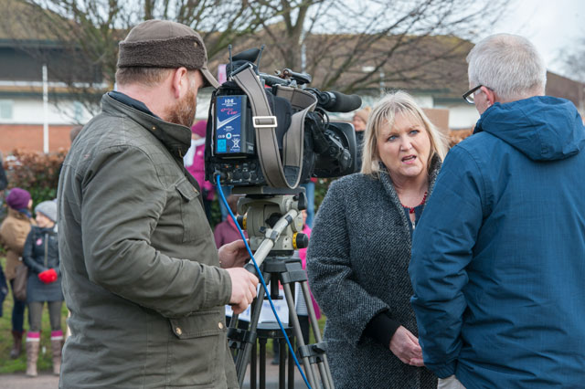 Karen Constantine talks on camera to a TV news crew