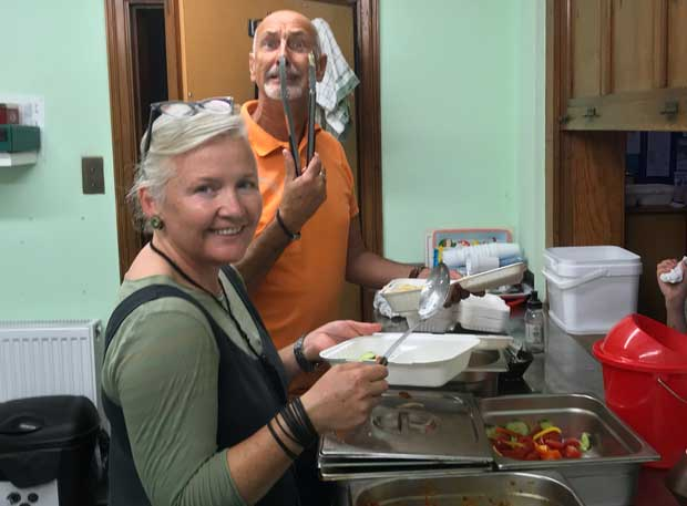 Steve Albon and Theresa Smith prepare for another round of meals at the Summer Kitchen in Newington