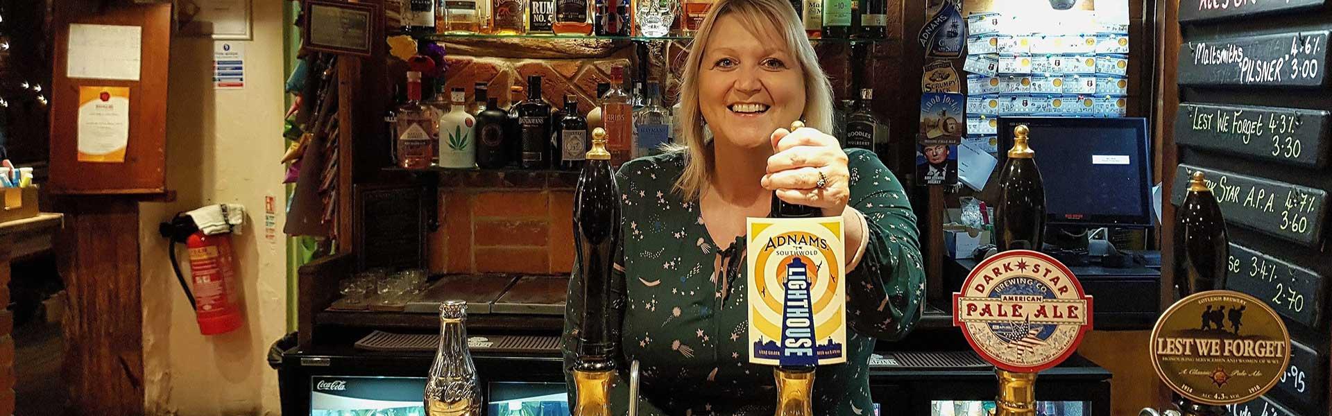 Karen Constantine behind the var in The Churchill Tavern, Ramsgate