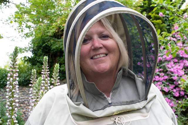 Karen Constantine tending a friend's bees