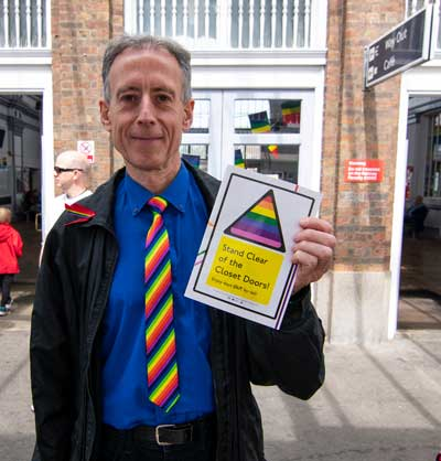 Peter Tatchell with the Community Rail Lancashire LGBT booklet. Photo: Lillian Constantine