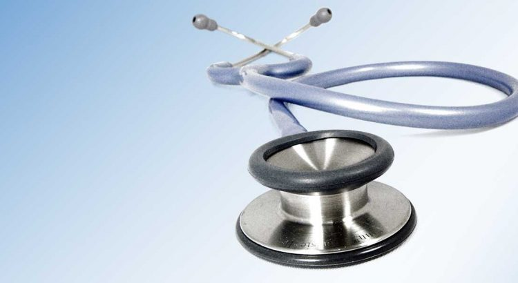 A GP's stethoscope on an NHS blue background