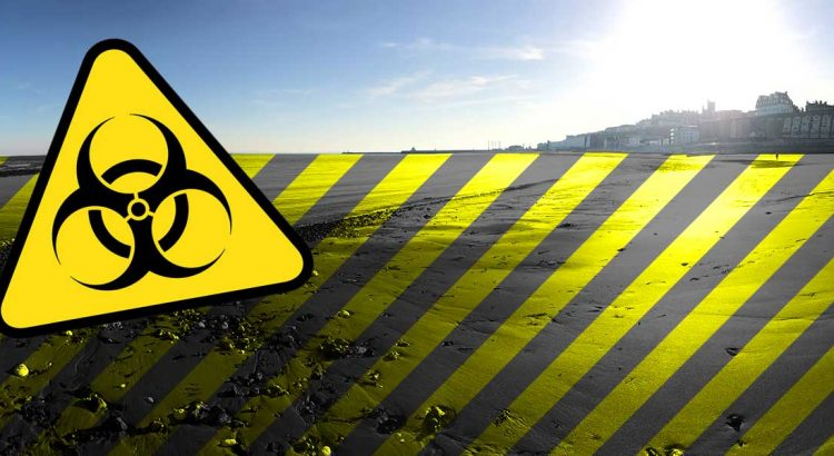 The Thanet coast at Ramsgate with a biohazard warning sign
